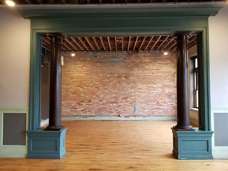 A photo of an open craftsman style archway in an old brick building