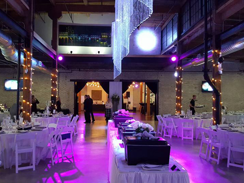 loft venue lit up for a wedding reception