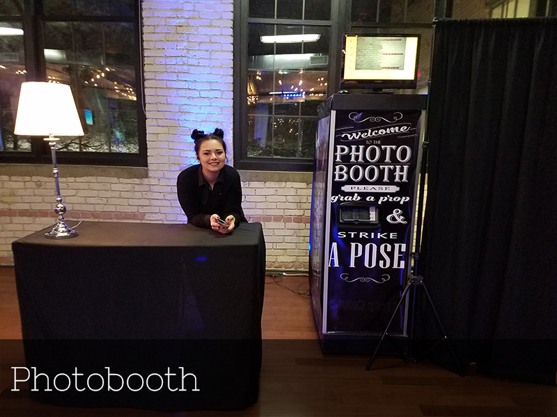 A photo of an attendant running a photobooth