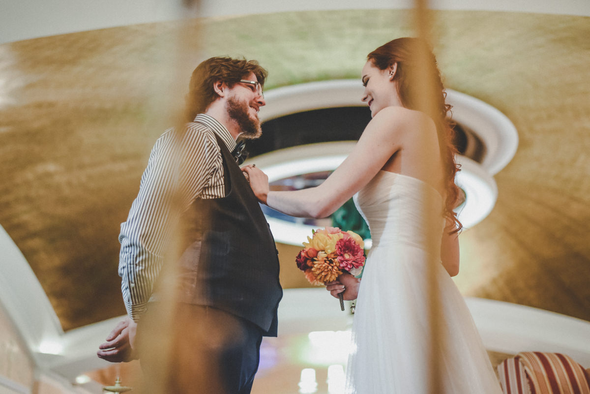 Groom looking at bride for first time on wedding day