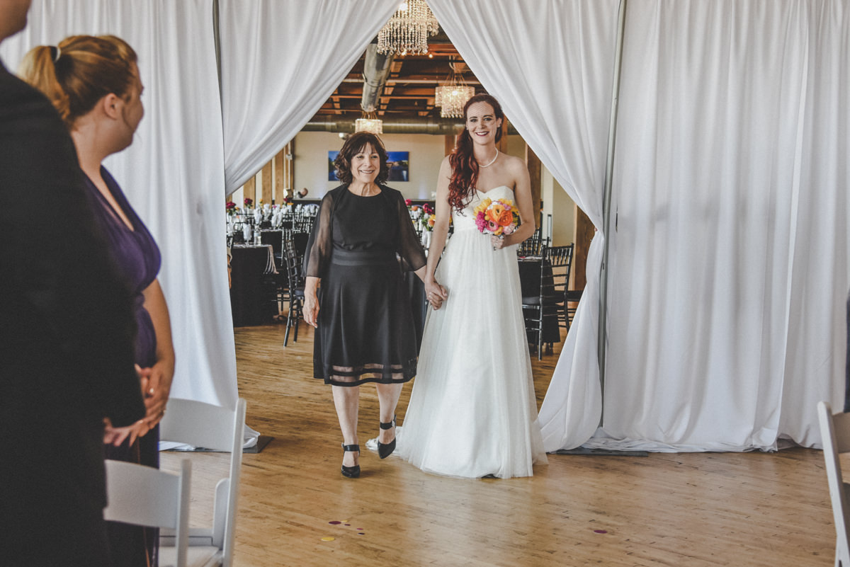 Mother of the bride walking her daughter into the wedding ceremony