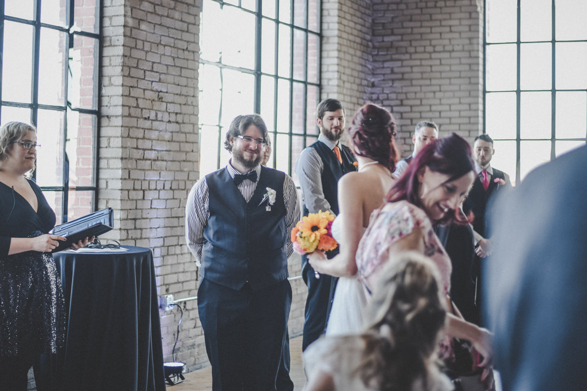 Groom seeing his bride in the ceremony for the first time
