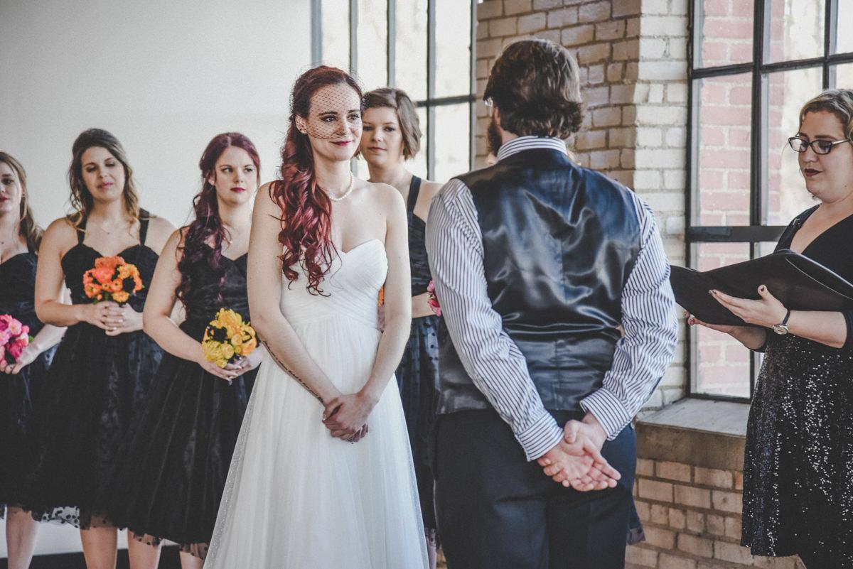 Bride looking at groom during wedding reception