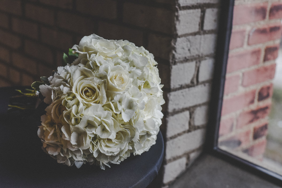 a bridal bouquet with white roses and hydrangeas