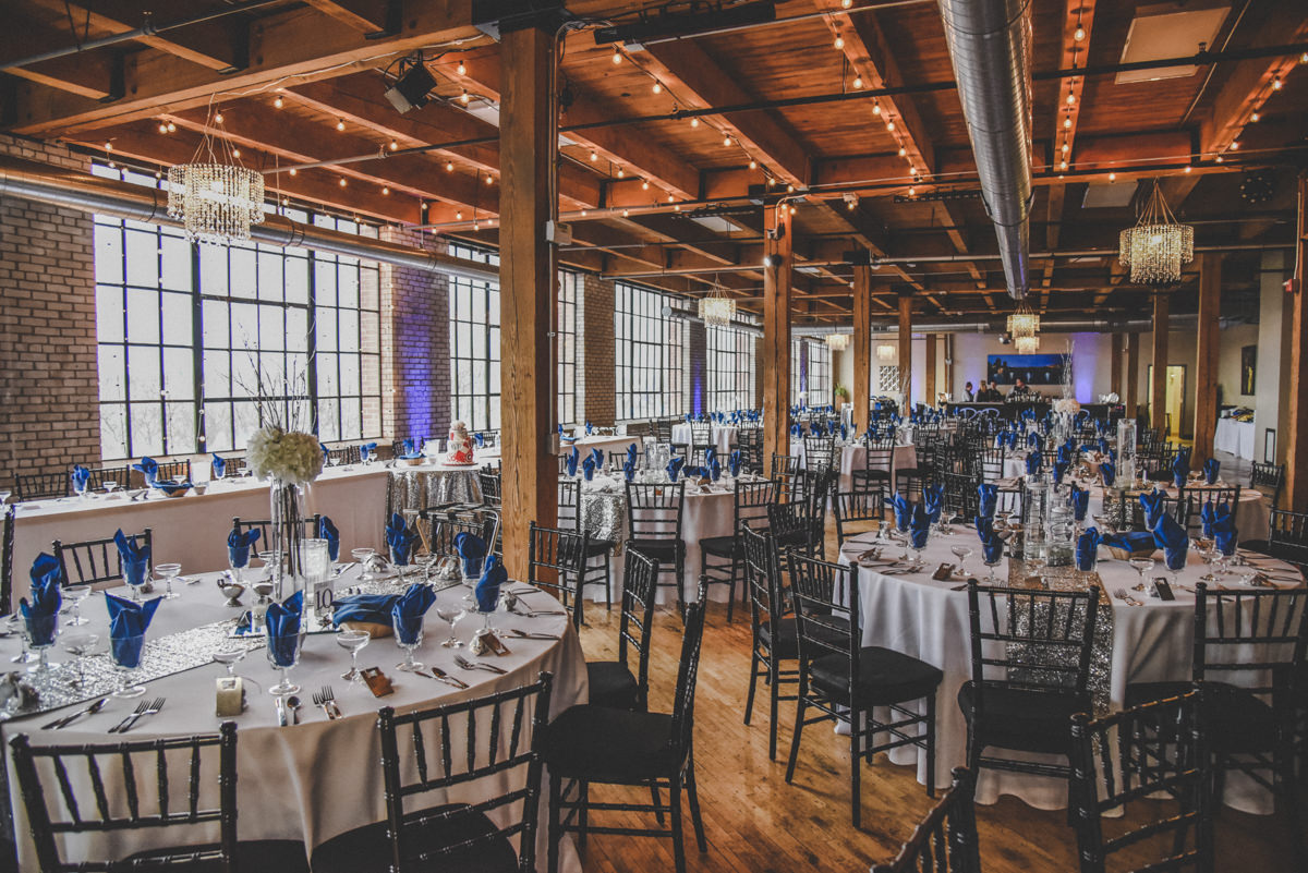 Studio D2D City View Venue reception with blue and silver decor