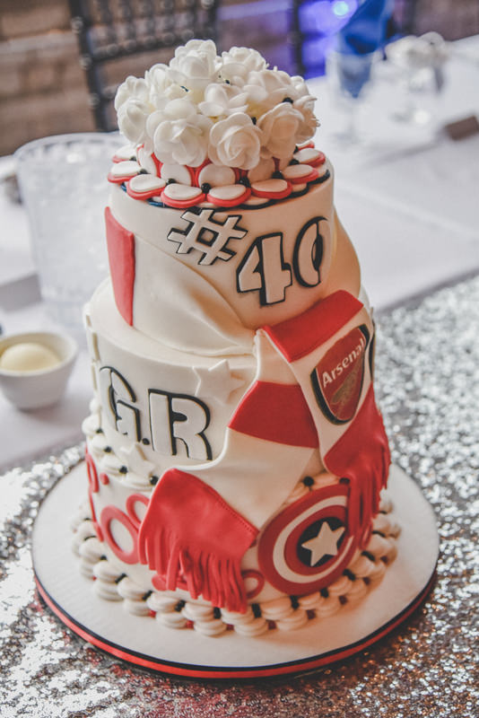 red and white hockey decorated wedding cake