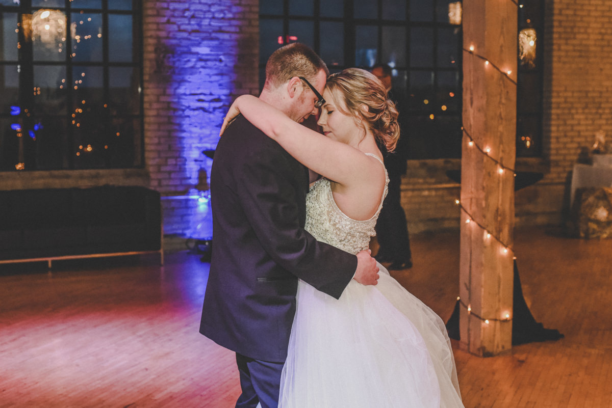 bride and groom holding each other during first dance
