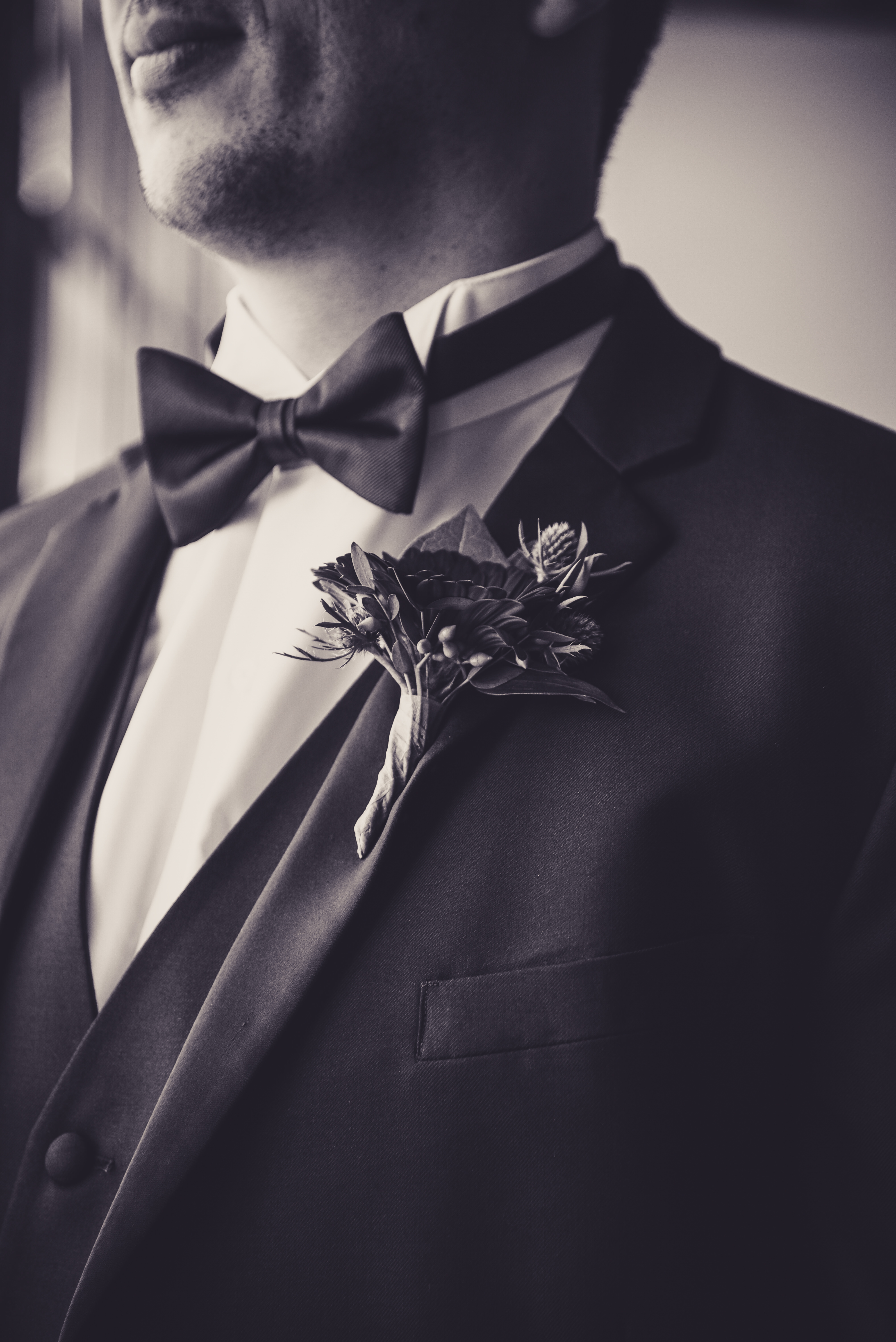 close up of grooms boutonnière