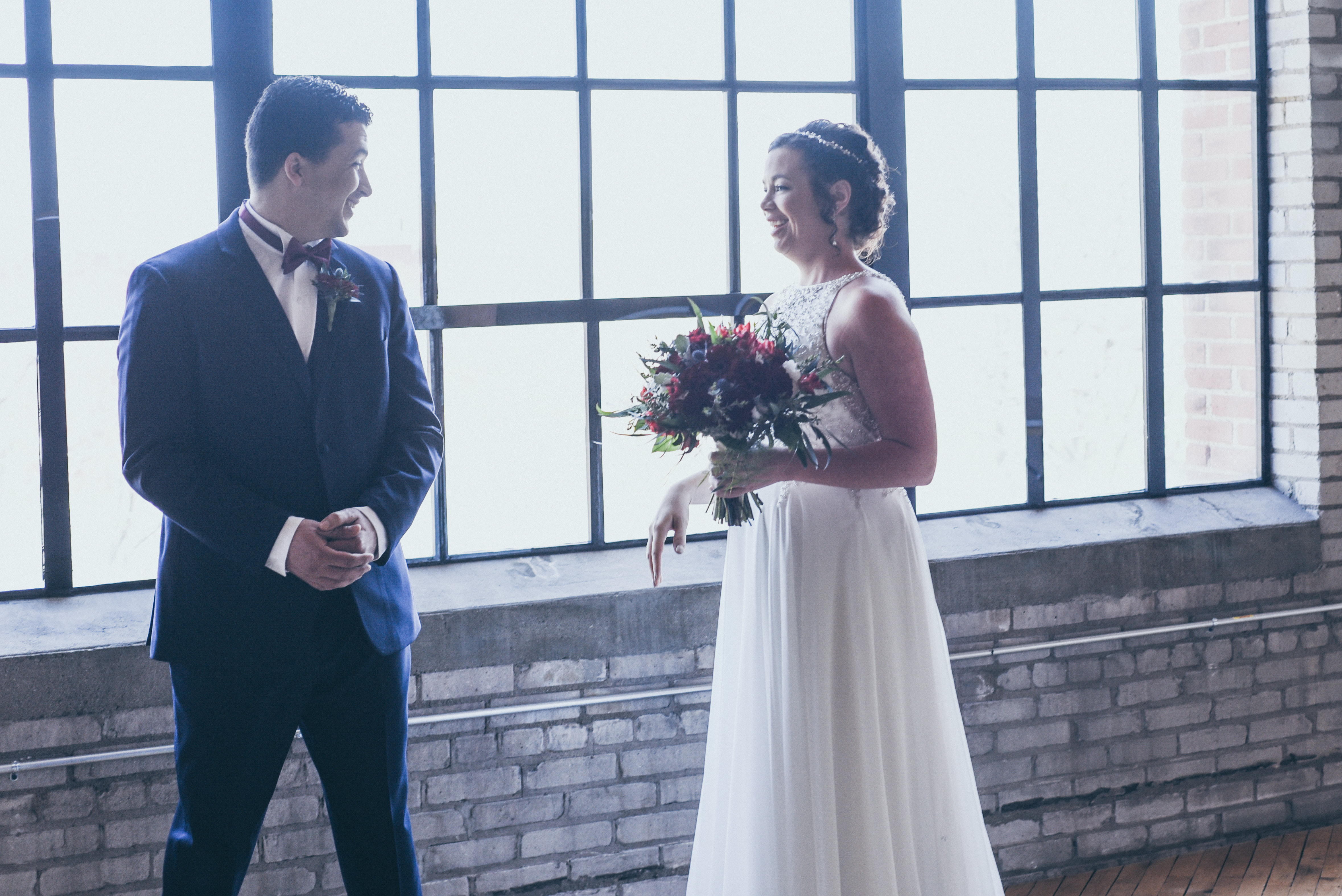 groom seeing bride for first time before wedding ceremony