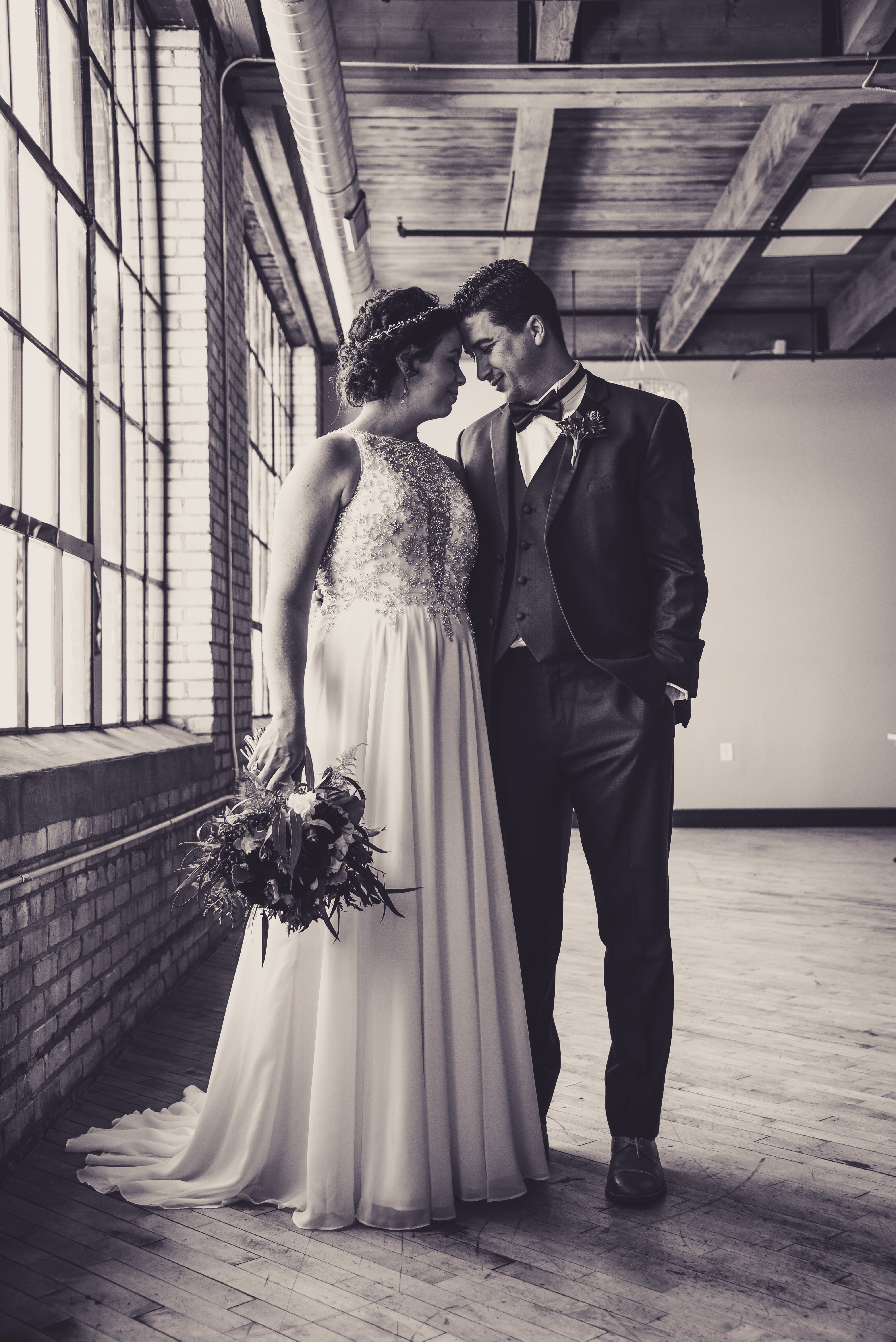 Bride and Groom together in an industrial loft venue