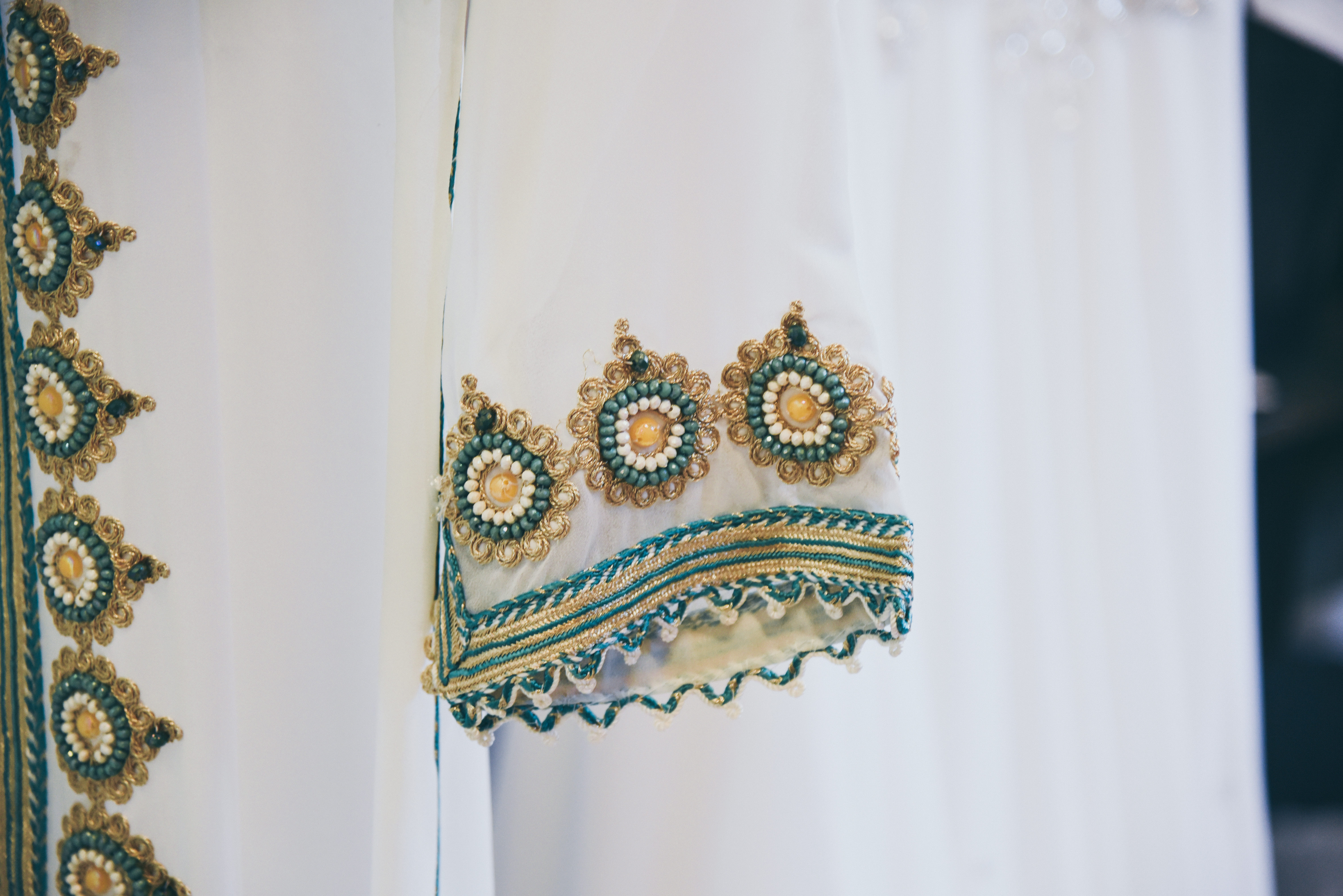 bride's moroccan wedding outfit in white, teal and gold