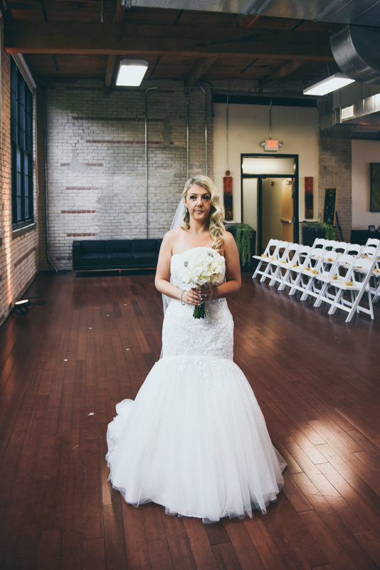 Bride waiting in loft venue for her father