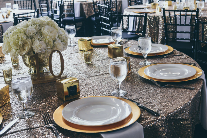 golden tablescape at a wedding in a loft venue