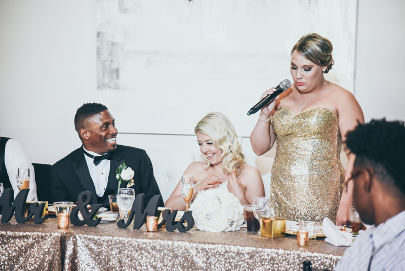 bridal party giving speeches at wedding reception