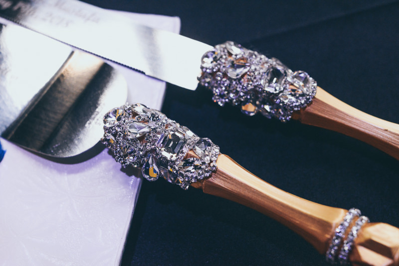 bejeweled and golden cake cutting utensils