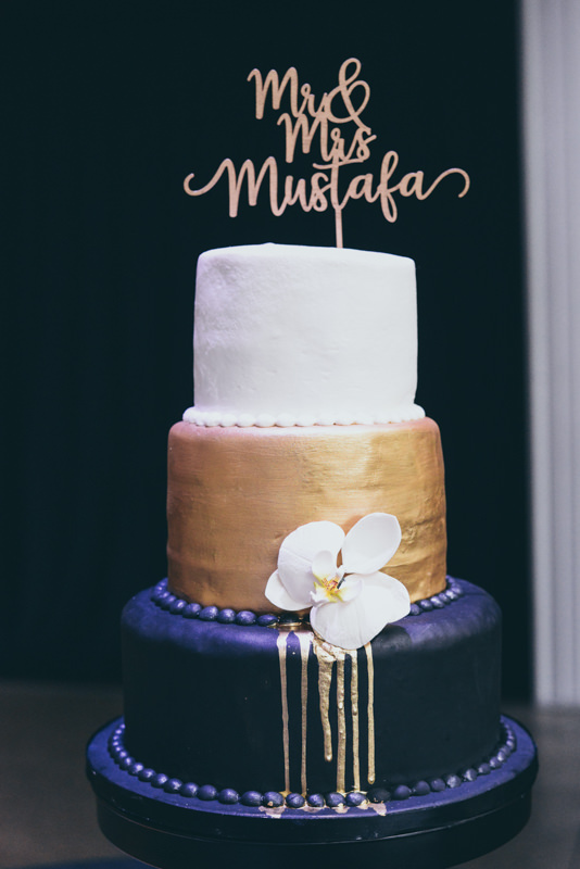 gold and navy wedding cake with u of m groom's cake