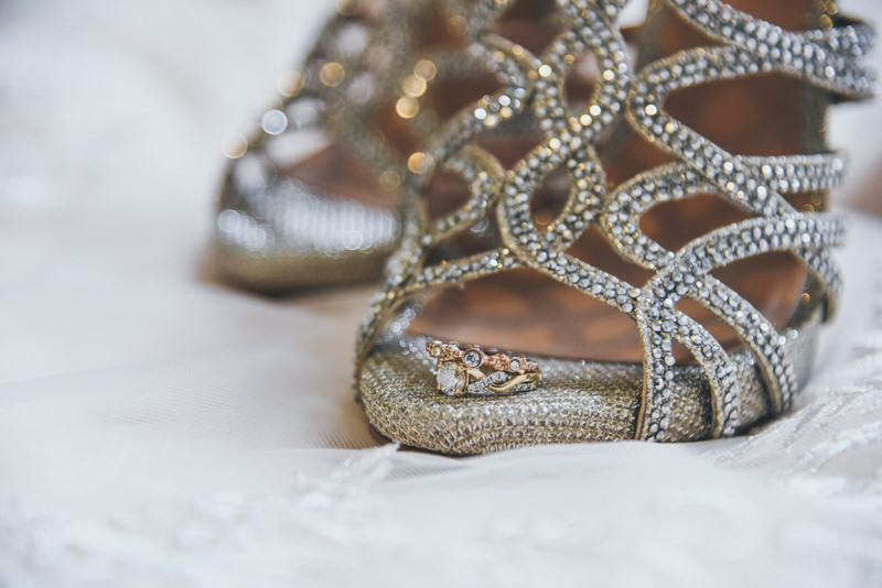 image of wedding rings on the toe of a very sparkly shoe