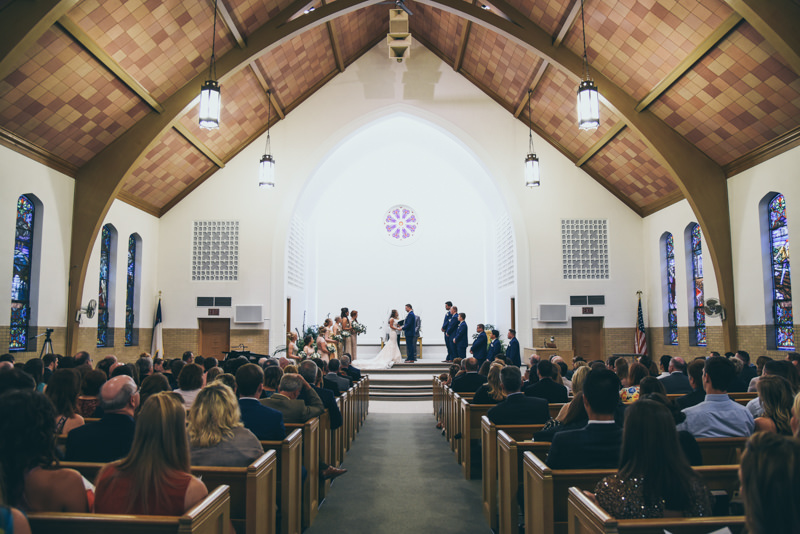 wide photo of a wedding in an old church