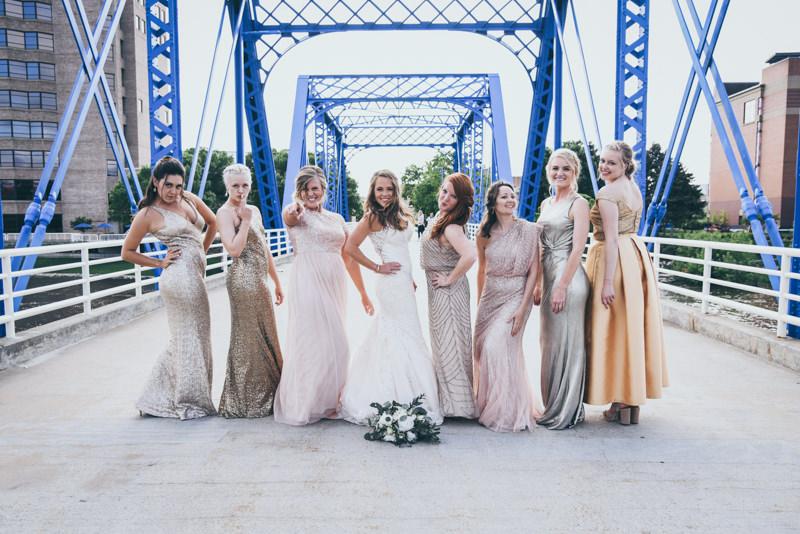 bride and bridesmaids on a blue bridge