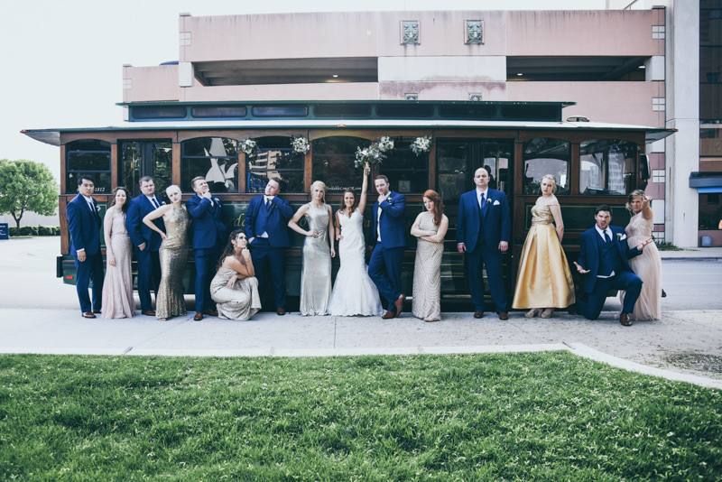 bridal party in front of a trolley at wedding reception