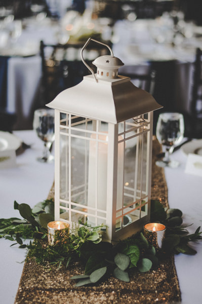 white lantern wedding centerpieces with greenery and candles