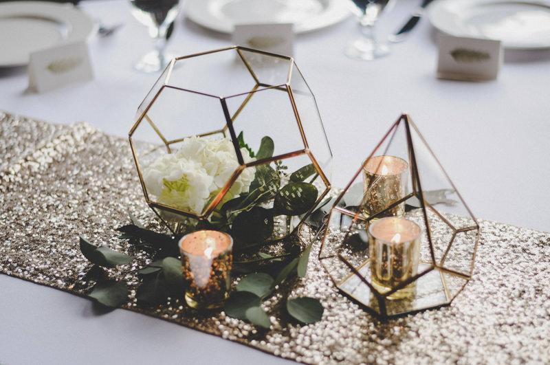 image of sparkly gold terrarium wedding centerpiece