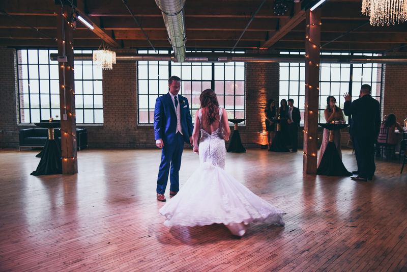 bride and grooms first dance in an industrial loft