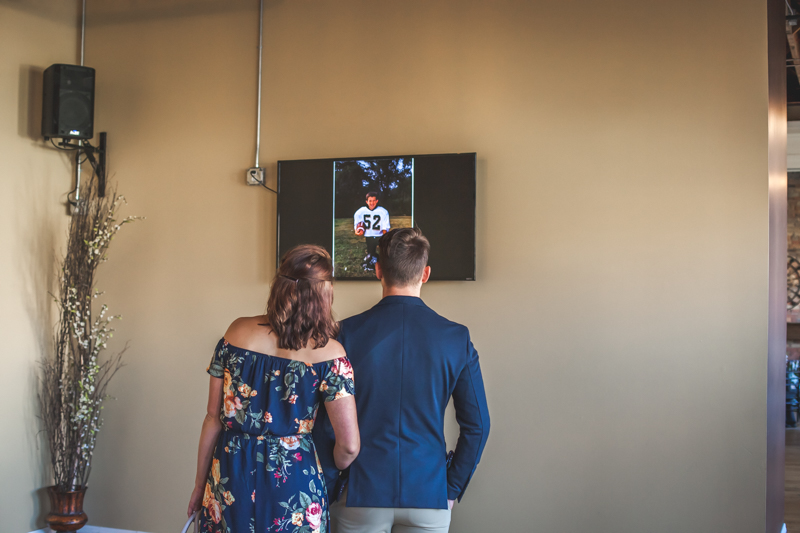 guests watching a slideshow at a wedding reception
