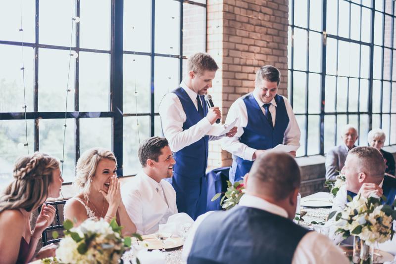 groomsmen giving speech at wedding