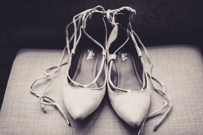 black and white images of bridal shoes with laces