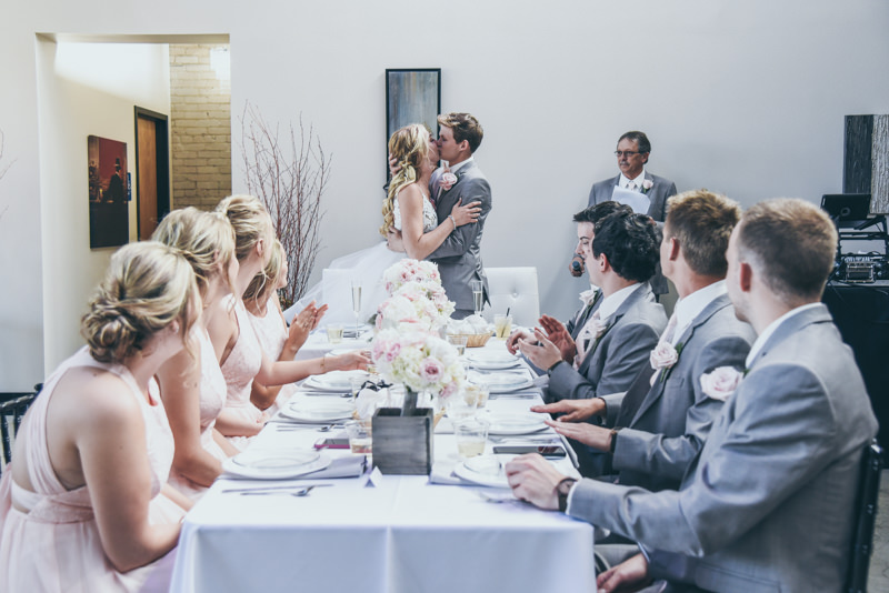 bride and groom kissing during wedding reception