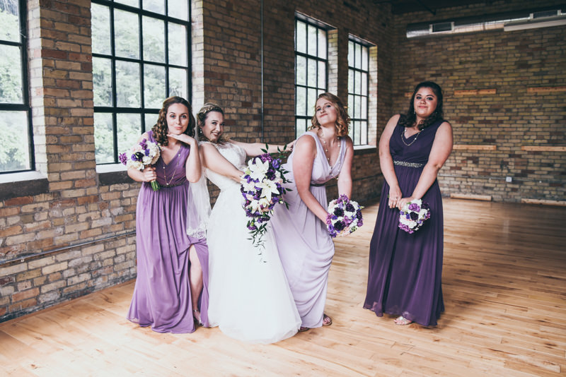 a bride and her bridesmaids having fun and goofing around