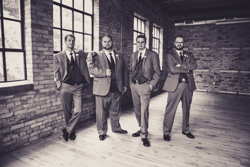 black and white image of a groom and his groomsmen