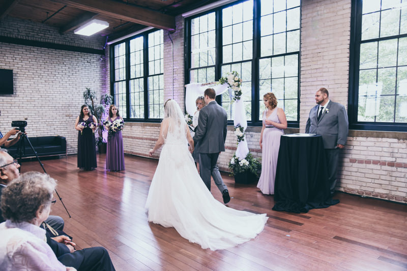 bride and groom walking back to the altar after signing marriage license