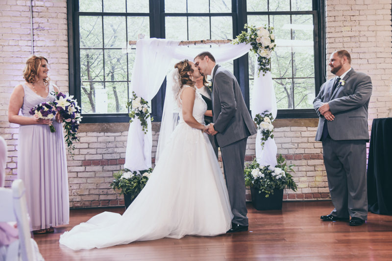 first kiss between bride and groom during ceremony