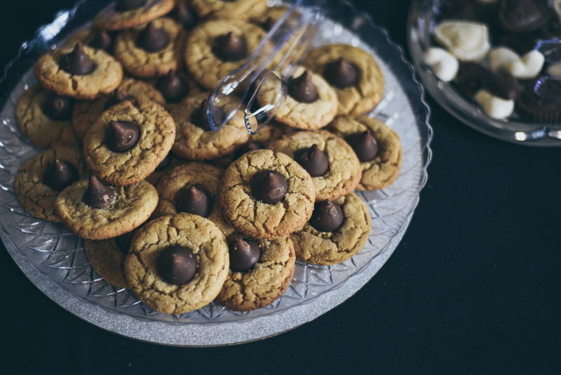 a platter of peanut butter cookies with hershey's kisses