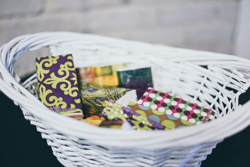 basket of tissues for guests at a wedding ceremony