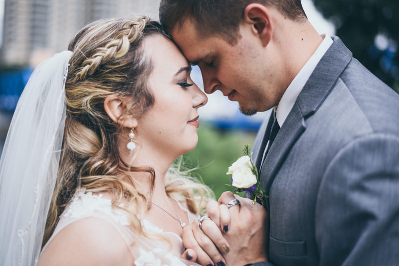 bride and groom facing each other and holding each other close