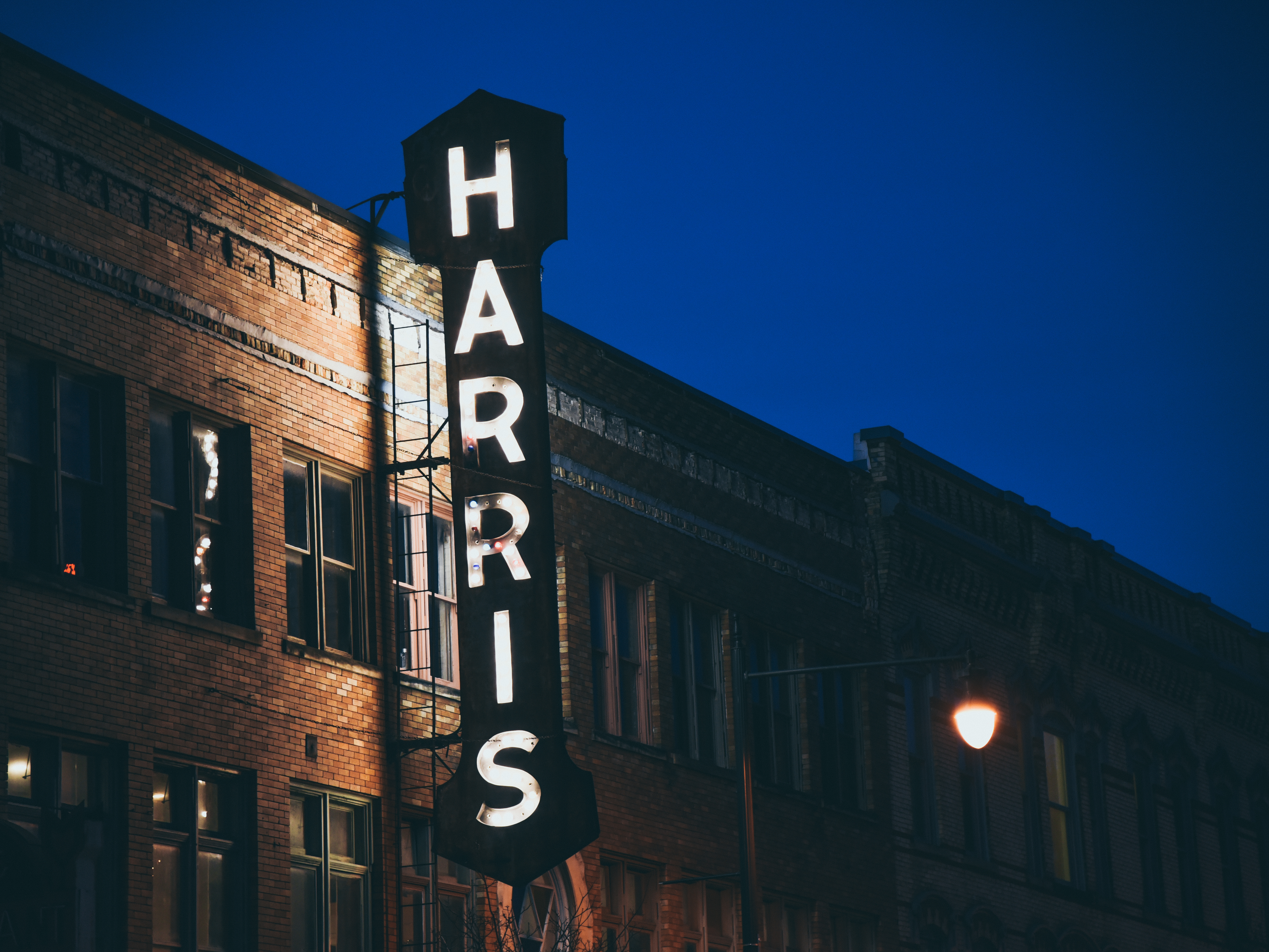 harris building sign lit up at night