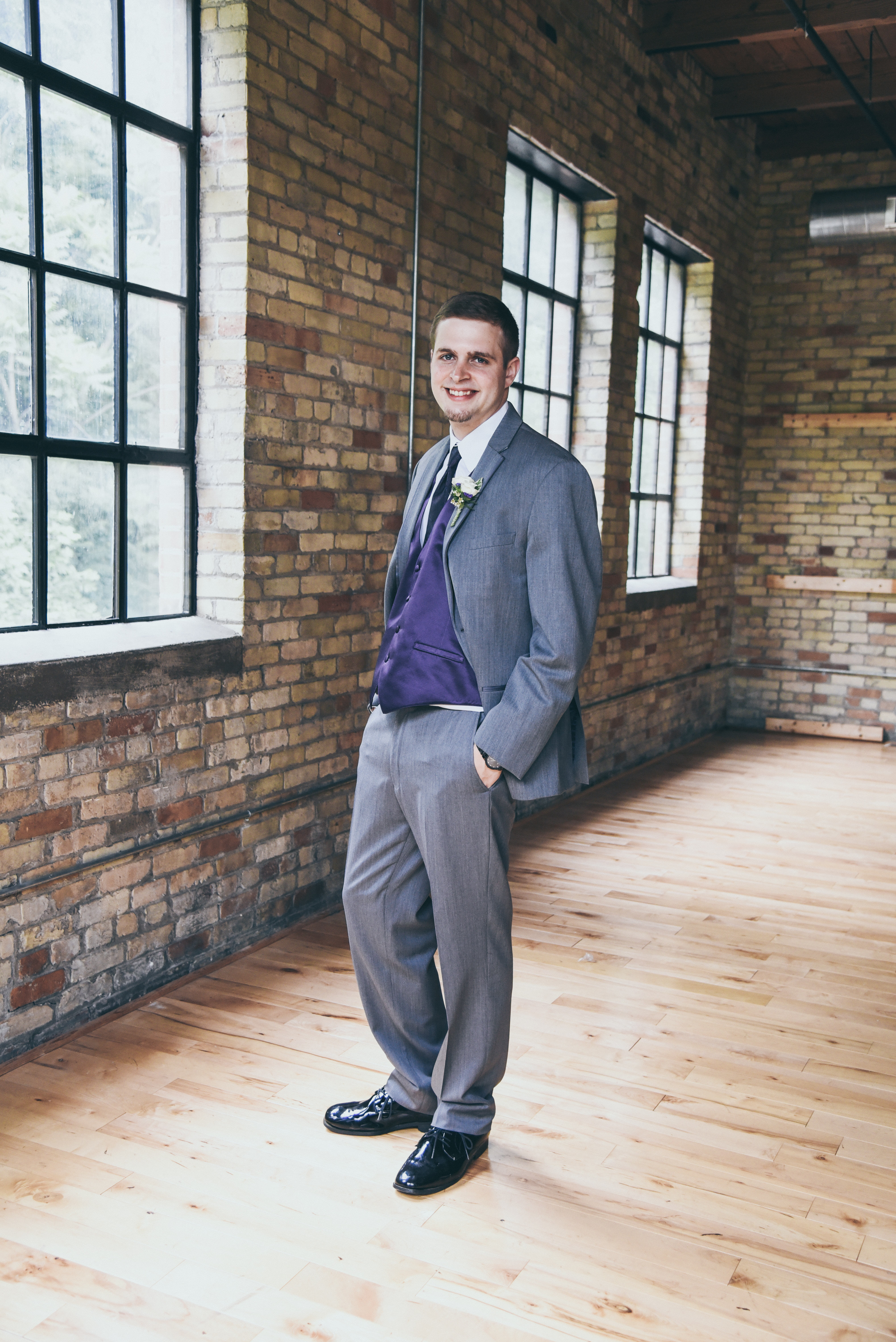 groom dressed in gray and purple