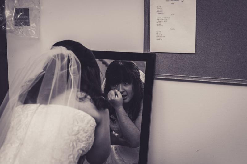 bride getting ready in a mirror