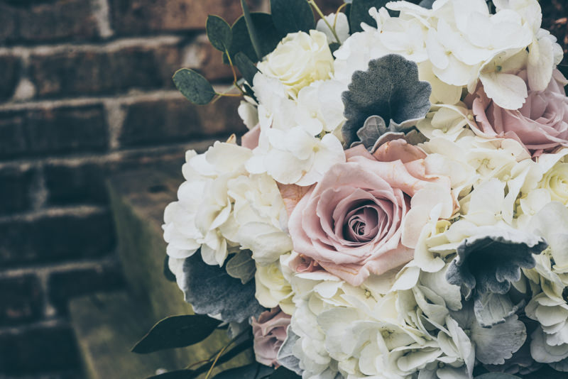 beautiful bridal bouquet with pink roses, white hydrangeas and greens