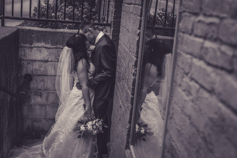 black and white image of the bride and groom in a stairwell