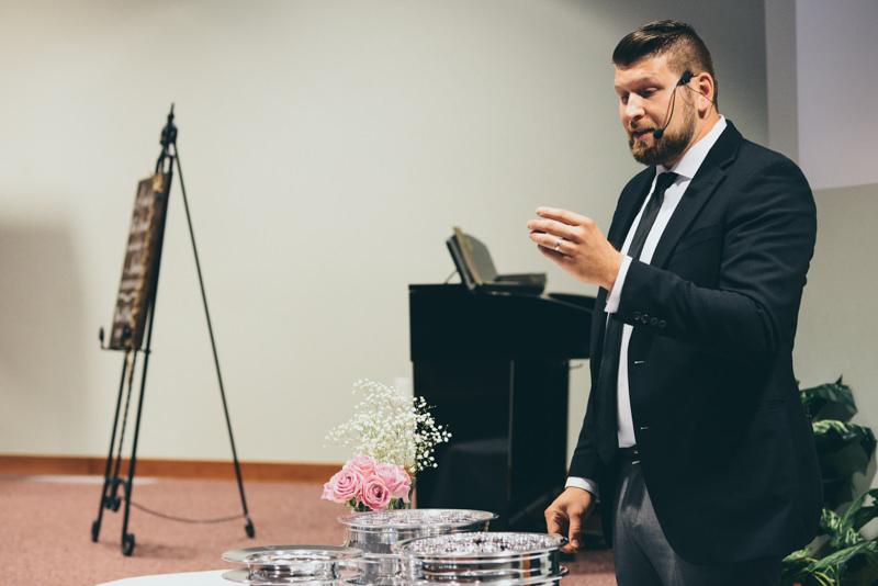 pastor leading communion