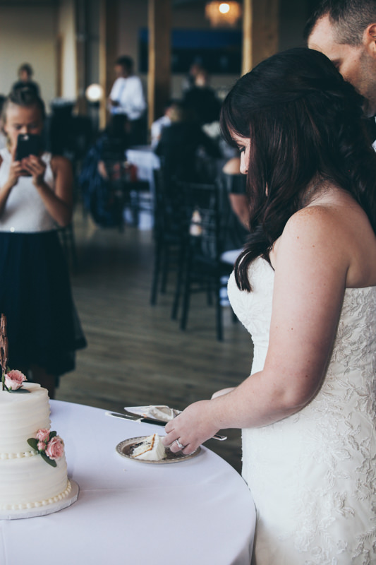 bride and groom during cake cutting