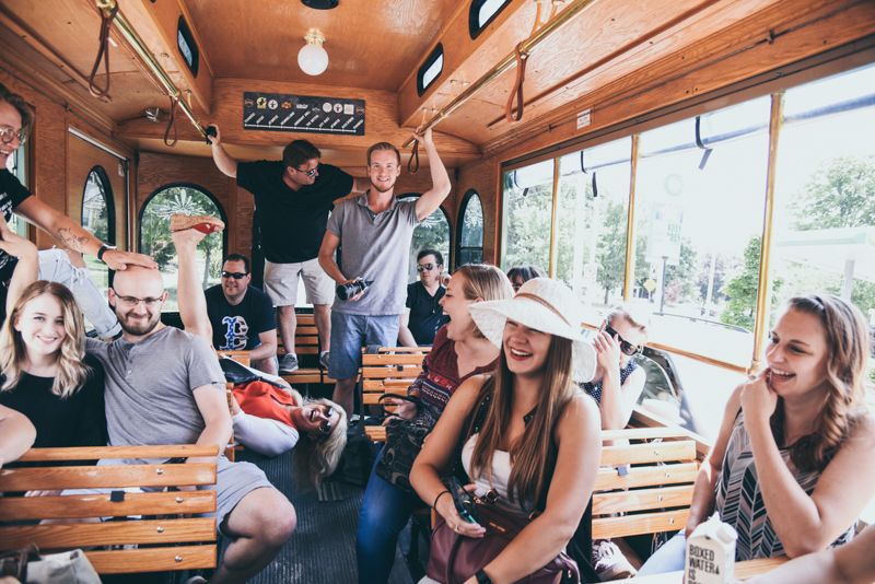 group of people having fun on a trolley