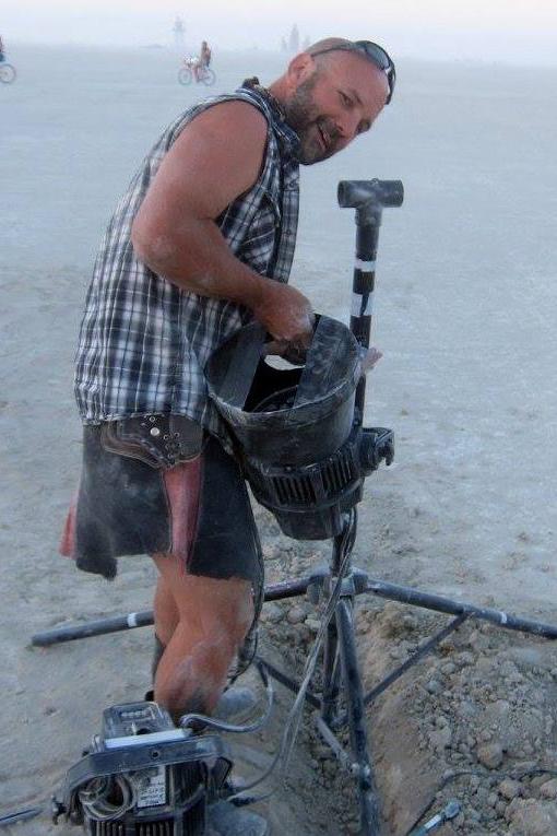 man working equipment on a beach