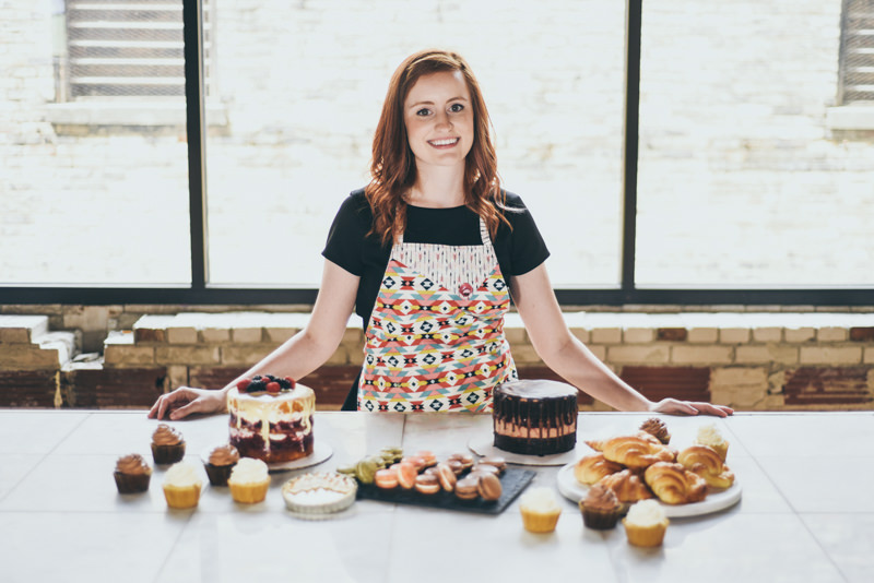 a pastry chef with a selection of baked goods