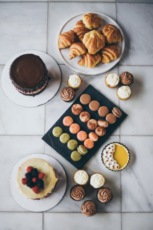 a display of baked goods and pastries