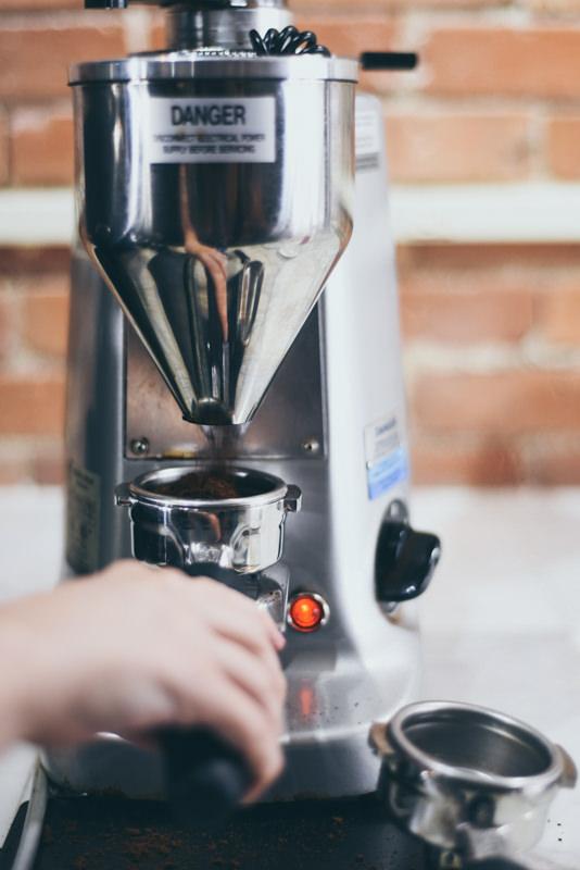 barista grinding beans
